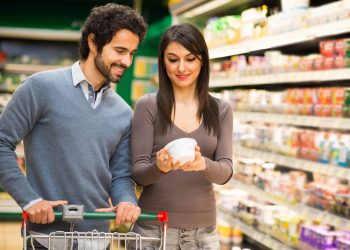 Young couple choosing food in a supermarket